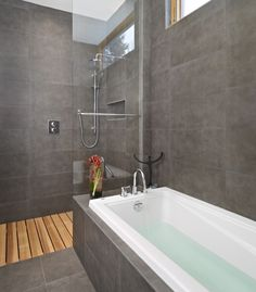 a DIY concrete shower Pan filled with outdoor wooden decking. that could be a great cheap alternative to a bathroom pan etc...