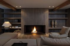 20 Of The Most Amazing Modern Fireplace Ideas interior corrugated material is cool. also having an enormous fireplace with center wood looks surprisingly nice. Linear Fireplace, Home Fireplace, Fireplace Surrounds, Fireplace Design, Fireplace Ideas, Fireplace Mantels, Wood Mantle, Fireplace Modern, Gas Fireplaces