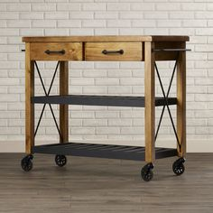 Features: -Material: Solid hardwood and wood veneers. -Heavy duty industrial style metal casters. Product Type: -Kitchen Cart. Base Finish: -Natural. Base Material: -Wood. Counter Material: -Woo