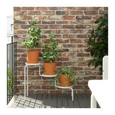 """IKEA PS 2014 Plant stand indoor/outdoor 20 ¾ """" $19.99 shelf holds a pot with a max. diameter of 8¼""""."""