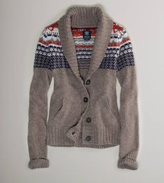 I want to snuggle up in front of a fireplace, sipping hot cocoa, wearing this sweater.