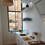 White kitchen White metro tiles The Manhattan Printing House, NYC White Kitchen Appliances, Kitchen Cabinets, Kitchen White, Mad About The House, Grey Wood Floors, Metro Tiles, Brick Tiles, Flat Ideas, White Tiles