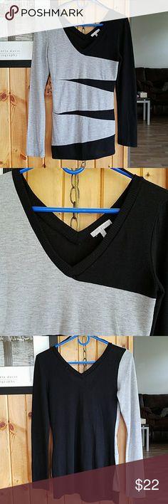 Grey and black long sleeve shirt Grey and black long sleeve shirt.  Very cute. Great condition. Tops Tees - Long Sleeve