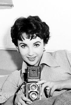 Elizabeth Taylor with a Rolleflex camera, 1950s.