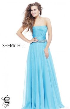 Classic and simple, Sherri Hill 1475 is a great option for tons of formal occasions!  This A line dress has a very flowy skirt which has a movement of its own when you walk.  The bodice is strapless with a ruched zig zag pattern.  A strip of rhinestones define the waistline and give this dress a little shimmer!  It is available in Aqua, Fuchsia, Ivory/Multi, Lilac, Medium Blue, Royal, and Yellow.