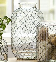 Our Large Pickle Jar Chicken Wire Glass Vase is an updated take on a vintage design. Classic chicken wire lends charm and texture to this versatile glass jar. Our vase is perfect for floral displays, kitchen utensil storage and more. Calista used wire and Pickle Jar Crafts, Pickle Jars, Mason Jar Crafts, Bottle Crafts, Chicken Wire Art, Chicken Wire Crafts, Kitchen Utensil Storage, Wired Glass, Cut Glass