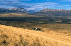 lone house in the vastness of Patagonia grassland