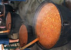 Large pots of stew!  yum!  Secrets to Brunswick Stew - the stirring, the seasoned kettle, love, and elbow grease give this stew it's flavor - a true American Tradition. The Stew Masters flavor and taste the stew as it is stirred with boat paddles until it's just right. Lots of money has been made by organizations everywhere - making and selling this famous stew. Happy Twirls!