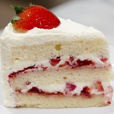 A Lovely recipe for layered fresh strawberries with cream cake.