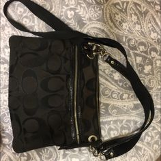 Black cross body coach purse Super cute coach purse, in mint condition.. Stains on the inside but very flashy on the outside! Coach Bags Crossbody Bags