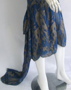1920s gold lame cocktail dress with attached train | From a collection of rare vintage evening dresses at http://www.1stdibs.com/fashion/clothing/evening-dresses/