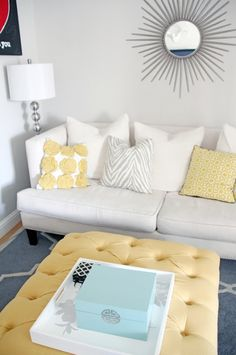 Gray, White, and Pale Yellow A soft color combination such as this makes for a serene feeling living room.