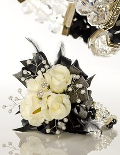 black silver white prom corsages - Google Search This could work for wedding corsages with some red.