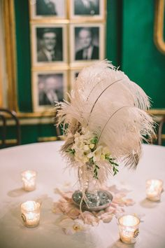 Art deco, or Great Gatsby wedding event theme is maybe one of my favorite since it's trendy, absolutely beautiful and swank! Wedding Flower Arrangements, Wedding Table Centerpieces, Flower Centerpieces, Ostrich Feather Centerpieces, White Centerpiece, Centerpiece Ideas, Vintage Wedding Flowers, Vintage Weddings, Lace Weddings
