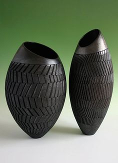2 vessels with slanted rims - height 45 cms and 55 cms