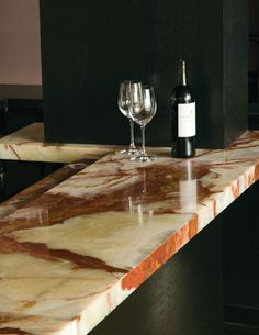 such a beautiful onyx surface for a bar top design | bar top