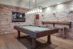 California Beach House with Modern Coastal Interiors Games room. Exposed brick walls bring a rustic feel to this games room. Home, Game Room Basement, California Beach House, Pool Table Room, Rustic Basement, New Homes, House, Coastal Interiors, Basement Decor