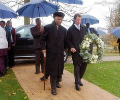 November 1, 2002: Former South African president Nelson Mandela paid his respects at the grave of Diana, Princess of Wales. He laid a wreath of white lilies and pale blue flowers beside the colorful patch of earth accompanied by Earl Spencer.
