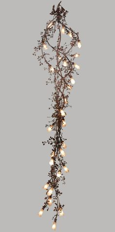 Rustic Chandeliers feature steel vine and leaf design.