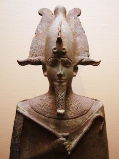 Ancient Egyptian statue of Osiris, lord of the dead, who was assassinated by his brother Seth and resurrected by his sister and wife, Isis. Now at the Louvre, Paris. c. 305-30 BC