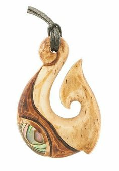 """NZ Maori Antiqued Bone Carving Paua Fish Hook Necklace KiwiKoru. $29.95. As each piece of bone is unique, no two will antique in the exact same way. Each piece will be as unique as the person who wears it.. Size (mm) 22 W x 31L (inch) (.80 W X 1.2 L)  (size may vary slightly). Comes with a 28""""-30"""" Fully adjustable Cord. Made from Renewable Resources (Bovine) Cattle Bone"""