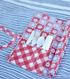 These roll-up placemats feature pockets for your utensils and napkin -- great for picnics! - I'm thinking this would be great any time the house is full. (I made something like this to hold tools for the bikes a long time ago. Why didn't I think of doing this for family get-togethers?)