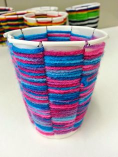 Weaving using paper cups.  This website has LOADS of craft ideas made for the classroom.