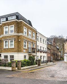 A lovely little corner of London's Kensington, complete with brick houses and cobblestones. #london #kensington #house