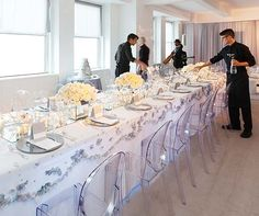 These lucite chairs supported the Winter Wonderland theme at Steph & Lela's Empire State Building wedding