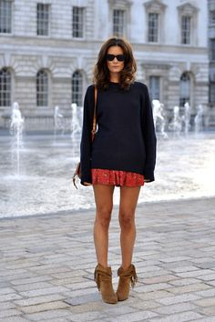 Great street style, love the red mini with chunky jumper and booties