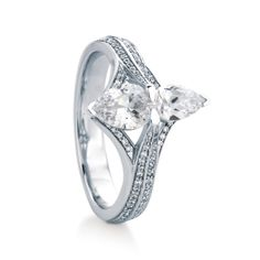 RAASAY/PAVE engagement ring by MaeVona: Pear-shape two-stone ring. Distinct and modern design, with two sizes of pear-shape set into a delicate metal frame with hand-set pave diamond accents. Named after the Scottish island of Raasay.