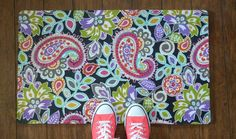 Mod Podge an eight dollar kitchen mat with your favorite fabric.