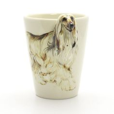 Afghan Hound Mug 00007  Dog Lover Gifts Ceramic Mug  Original hand sculpt and hand paint Afghan Hound Dog Mug  This Mug using a durable Stoneware Clay high fired at 1,250 Degrees Celsius for more durability.  Hand Sculpted and Painted featured Afghan Hound Head Handle. Hand Painted underglaze ceramic color on my own styles and techniques and then coating in clear glaze.  www.muddymood.com