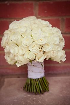 Image by Lola Rose Photography. Wedding bouquet. large bridal bouquet. White roses. hand tied bouquet