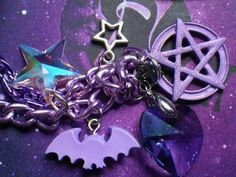 Beautiful purple pentagram combined with a bat, stars and a heart.