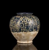 An unusual blue glazed baluster pottery jar,  Tang Dynasty, resting upon a flat base and with a short everted mouth above a dribbled blue glaze 17 3/4 in. (19.5 cm)  Estimate $ 4,000-6,000