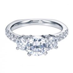 This charming engagement ring is adorned with glittering brilliant round prong set diamonds down each shoulder while 2 larger rounds accent your center diamond. Pledge your eternal love with the white gold carat total weight engagement ring. Three Stone Engagement Rings, Three Stone Rings, Diamond Engagement Rings, Rings For Her, Wedding Rings, Wedding Jewelry, White Gold, Diamonds, Proposal Ideas