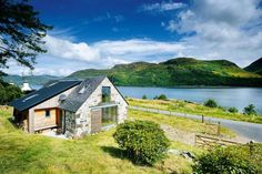 A charming stone barn conversion on a breathtaking loch-side site in the Highlands
