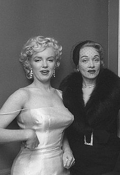 Marilyn Monroe and Marlene Dietrich during a press conference to announce the formation of Marilyn Monroe Productions, NYC, January 7, 1955.