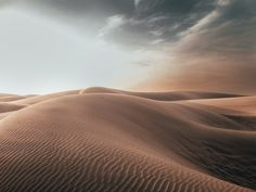 sand dunes at desert under grey cloudy sky photo – Free Nature Image on Unsplash