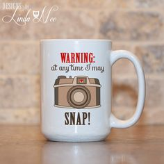 MUG ~ WARNING at any time I may SNAP ~ Gift for Photographer ~ Photography ~ Film Camera ~ Funny Coffee Mug ~ Coffee Mug ~ Mugs ~ Nerd Mug ~ Photos ~ Camera Coffee Mug ~ Humorous Photography Quote  ♥ AVAILABLE SIZES 15 oz 11 oz   ♥ ABOUT OUR MUGS ♥ All designs are personally created by me and exclusive to DesignsbyLindaNee ♥♥♥♥♥ http://etsy.me/1O2ftEU ♥♥♥♥♥ and DesignsbyLindaNeeToo ♥ Each mug is custom imprinted in our studio in Henniker, New Hampshire, using professional materials and…