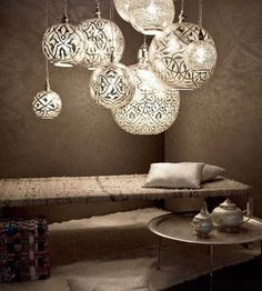 Arabian themed seating area. Loving the pendant ceiling lamps