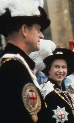 Queen Elizabeth II steals a glance at Prince Philip at a garter ceremony at Windsor Castle in 1957.