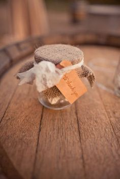 Omg ! We can do these for favors!!! baby food jars plus burlap!!