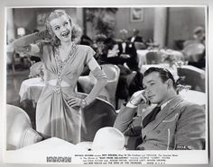 Roy Rogers and Dale Evans. I love his face here! Their constant bickering in the movies was adorable.