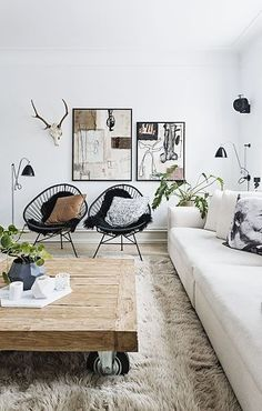 Chic living room with reclaimed wood coffee table and black modern chairs