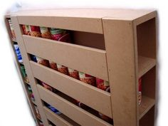 You may make a close inspection of this Book-shelf food can dispenser. This was made by Brother Grant Thompson. Design your shelf width and height based upon the size of the cans you want to store. Perhaps a similar shelf could be made to store preserved fruit in glass jars. A peg may be needed …
