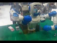 exter Bot deals cards at IMTS 2012 - via YouTube