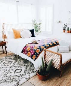 Fun bedroom!! I like the white canvas with lots of different colors on top. Very cozy, very stylish
