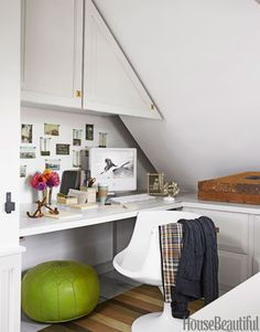 In Ken Fulk's Provincetown, Massachusetts, house, an upstairs office is tucked in a nook beneath the eaves.   - HouseBeautiful.com